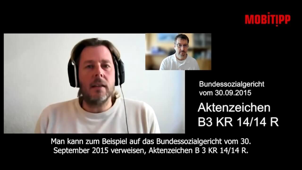Screenshot eines Mannes mit Headset beim Interview